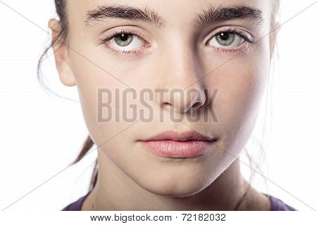 Close Up Portrait Of A Woman With Mysterious Looking Eyes