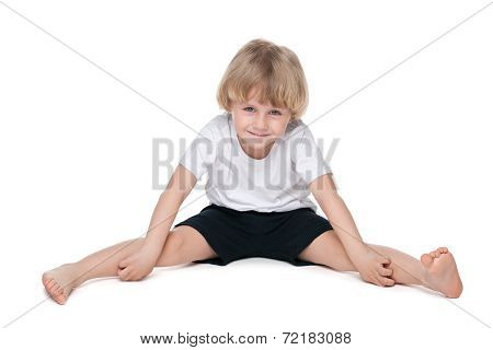 Small Boy Performs Gymnastic Exercises