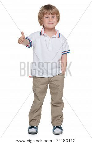 Small Boy Holds His Thumb Up