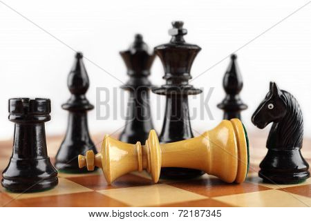 Chess concept. Checkmate white king. Background with free text space.