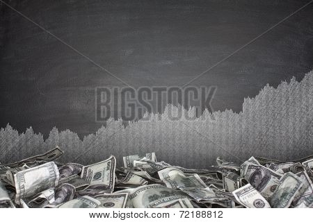 Pile of dollar bills on blackboard background