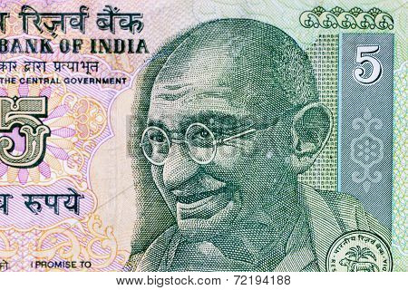 Closeup macro view of Mahatma Gandhi on an Indian currency note