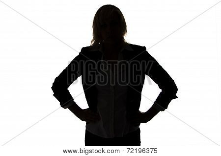 Silhouette of businesswoman with hands on hips