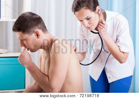 Coughing Man Having Examination
