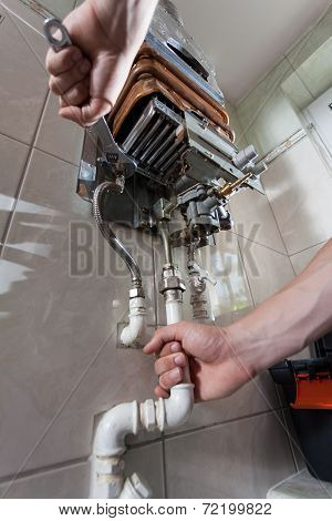 Handyman Repairing Gas Water Heater