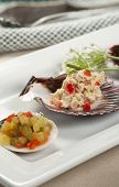 foto of scallop-shell  - A close up of tuna salad mixed with diced red bell pepper and topped with chives served on scallop shells with a side of freshly diced relish - JPG