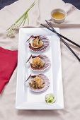 picture of scallop-shell  - A Korean delicacy called Chop Chae noodles served on scallop shells with a side of diced cucumber - JPG