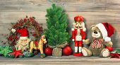 pic of nutcracker  - nostalgic christmas decoration with antique toys teddy bear and nutcracker - JPG