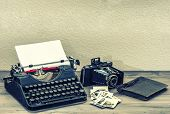 picture of old vintage typewriter  - Antique typewriter and vintage photo camera on wooden table - JPG