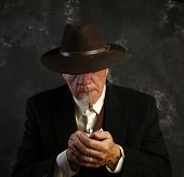picture of fedora  - Middle age man in fedora with cigar - JPG
