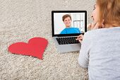 foto of video chat  - Happy Young Woman Having A Video Chat On Laptop - JPG