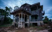 stock photo of abandoned house  - scary building abandoned old house on twilight - JPG