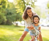 picture of mother baby nature  - Portrait of mother and baby girl with bicycle - JPG
