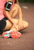 image of ankle shoes  - young woman runner hold her twisted ankle - JPG