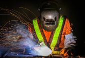 stock photo of welding  - worker work hard with welding process in production plant - JPG