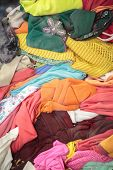 picture of thrift store  - stack of second hand clothes in a shop window - JPG