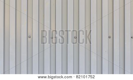 Surface of trapezoidal metal sheet with bolts
