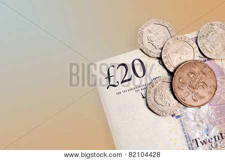 Twenty pounds and pence coins isolated on background