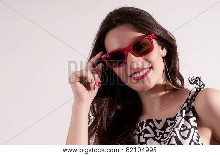 Pretty Woman Portrait In Red Sunglasses