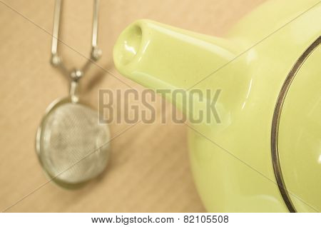 Lemon Green Teapot Spout And Background Strainer