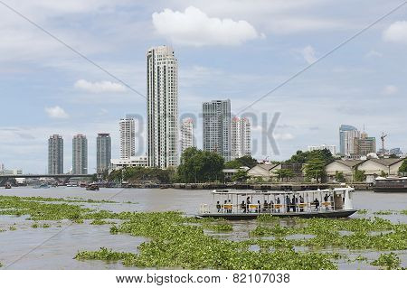 People cross Chao Phraya river by ferry boat in Bangkok, Thailand.