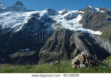 Cairn And Peaks In Snow Nearby Grindelwald In Switzerland