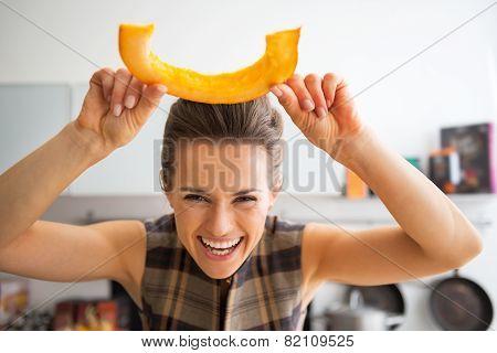 Happy Young Housewife Having Fun Time Using Cutting Pumpkin In K