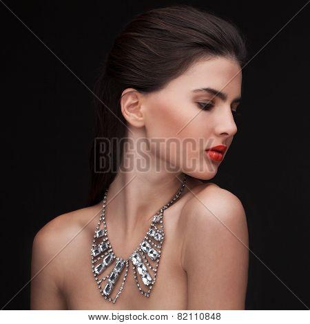young brunette woman nude studio portrait
