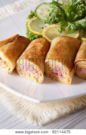 Crepes Stuffed With Ham And Cheese Close Up Vertical