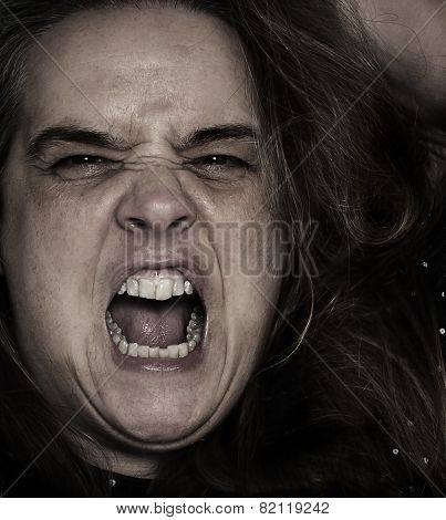 Middle-age woman screaming close-up