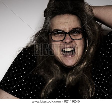 Middle-aged woman screaming