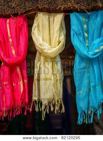 Multi-colored scarves at local market, India