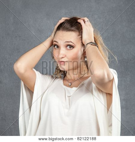 Puzzled Woman With Hands In Her Hair