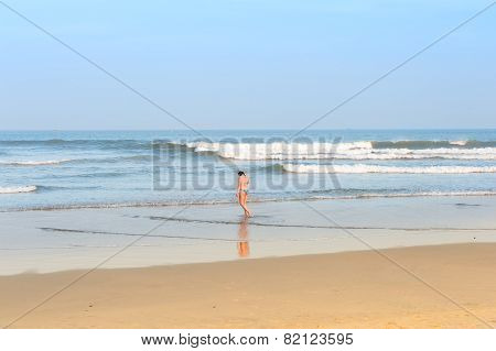 Beautiful Young Girl On The Beach View From Back