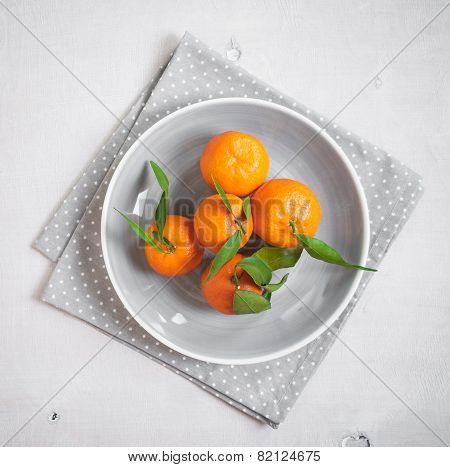 Tangerines On White Wooden Background. Grey Polka Dot Fabric