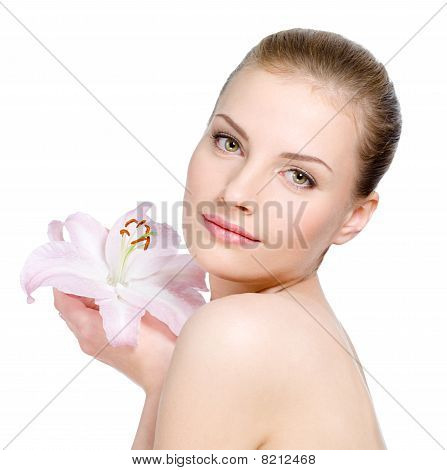 Woman With Health Skin Holding A Flower