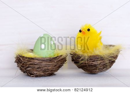 One Green Easter Egg And Yellow Chick In Nest