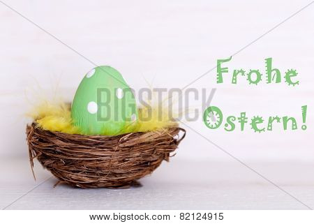 One Green Easter Egg In Nest With German Frohe Ostern Means Happy Easter