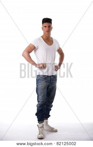 Trendy young man standing on white background