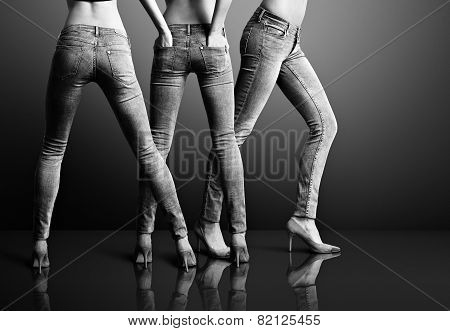 Three Woman In Jeans In A Dark Room. Bw
