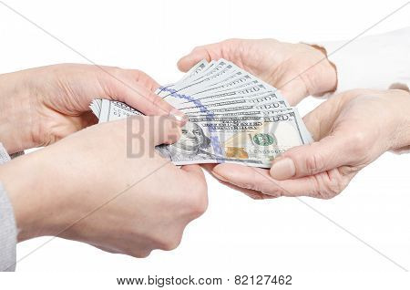 Hands giving money to other hands