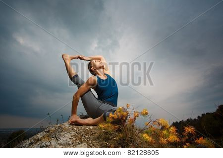 Woman doing yoga against the setting sun