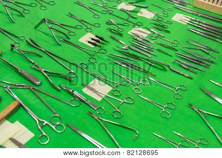 Medical instruments collection on green textile