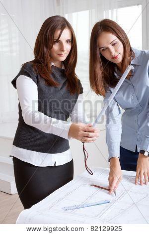 Female Architects Studying Blueprints