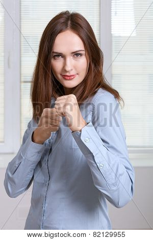 Girl Is Standing In A Pose Of A Boxer