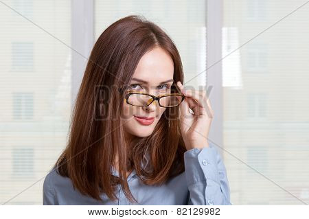Girl In Formal Attire Looking Over His Glasses