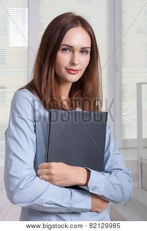 Girl In Formal Attire Holding A Folder