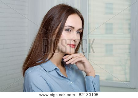Girl Has A Sideways Attaching Her Hand To Her Chin