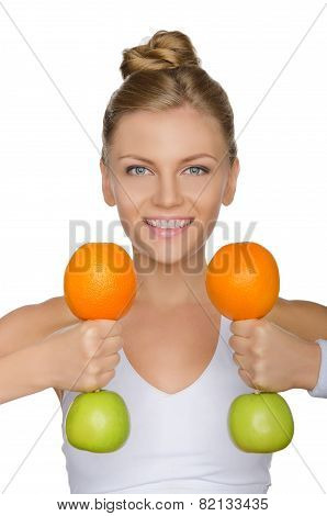 Beautiful Woman With Dumbbells From Fruits