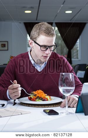 Young Businessman Eating At A Restaurant.